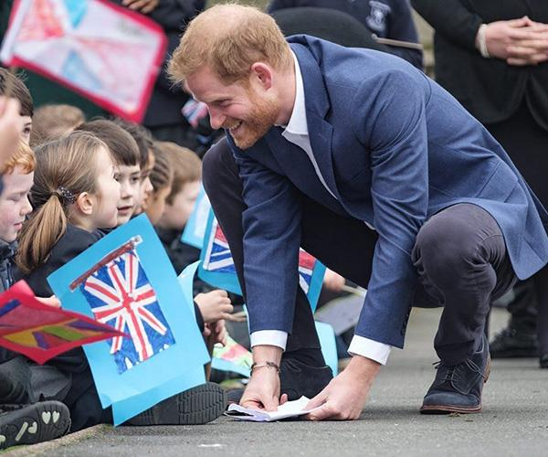 Prince Harry showed his paternal side with local schoolchildren. *(Image: Instagram @kensingtonroyal)*