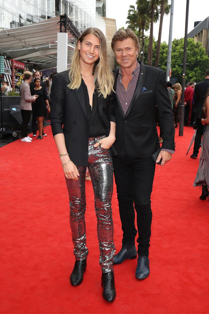 Richard Wilkins (R) and his youngest son Christian Wilkins (L) on the red carpet. *(Image: Getty)*