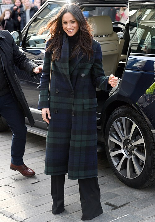 """The ultimate style muse, [Meghan's tartan coat](https://www.nowtolove.com.au/fashion/fashion-trends/kate-middleton-meghan-markle-coat-54517