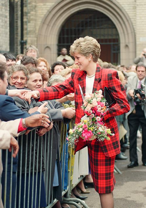 Making a statement! Diana went all out in a matching tartan skirt suit while on a walkabout in Manchester in 1991.