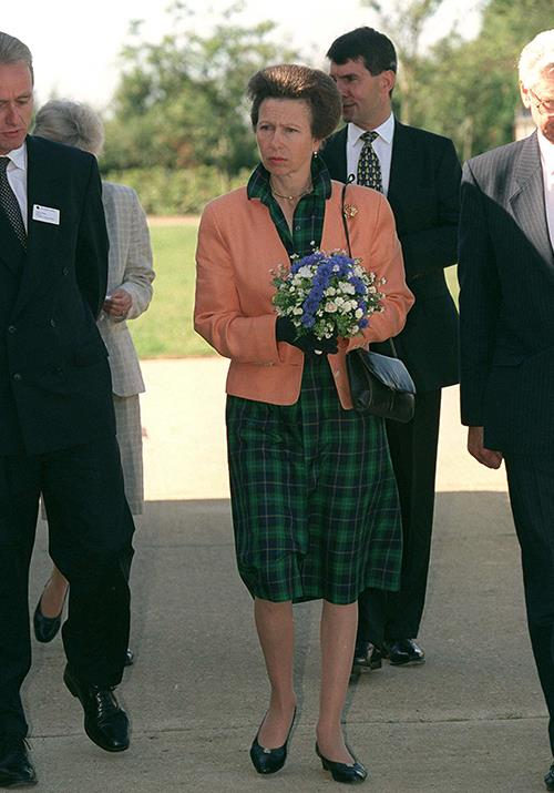 Anne's on board! We're loving this green tartan dress on the Princess as she visited The Blue Cross' Animal Adoption Centre in September 1999.