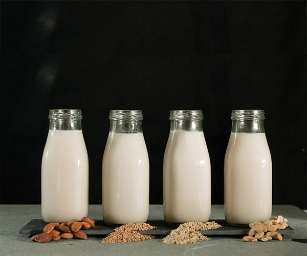 There are a variety of milks out there ranging from almond to soy. *(Image: Getty)*
