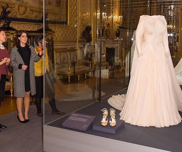 Eugenie's wedding dresses are currently on display at Windsor Castle. *(Image: Getty)*