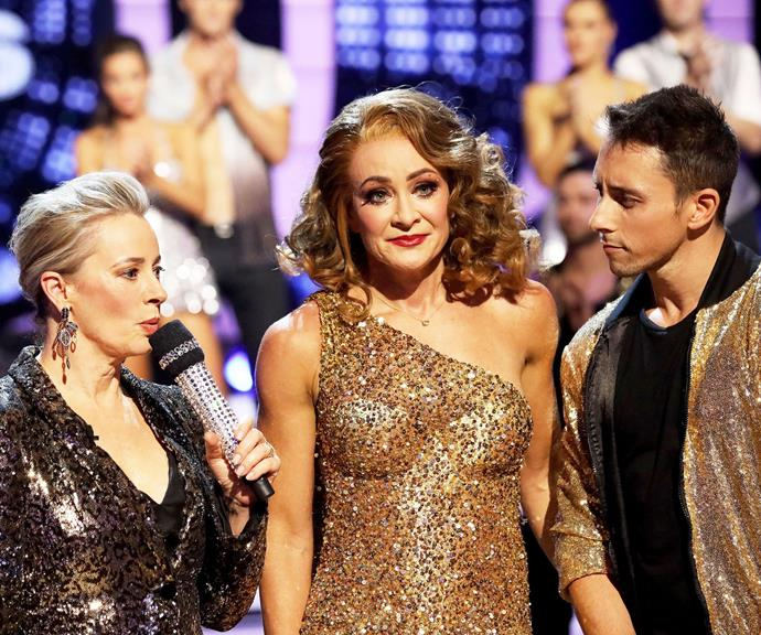 Michelle Bridges (centre) with her dance partner Ari and host Amanda Keller, following her elimination. *(Image: Channel 10)*