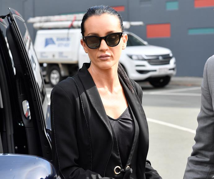 Ines leaving a Mercedes limo outside a Brisbane court. *(Image: AAP)*