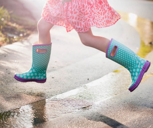 **Embrace the rain:** Cabin fever from drizzly weather? Why not don the wellies and head out into the mud? The world is an incredible place in the rain, and you never know what fun you might find on an adventure to your local park, or even your own backyard when you rug up and brave the weather. *Image: Getty.*