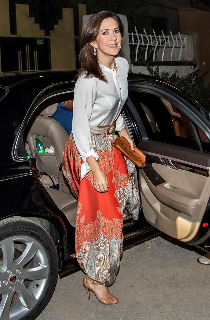 Crown Princess Mary was a vision in this gorgeous paisley skirt and satin shirt. *(Image: Mega)*