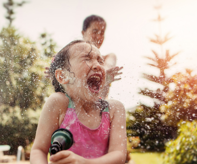 **Water play:** While hitting a backyard with the hose or a sprinkler is great fun, even a small waterplay table set up on a balcony will keep kids entertained and cool in the summer holidays. Buckets, tubs, cups, colanders, water balloons, ice and sponges make great props. Remember to always supervise kids around water. *Image: Getty.*