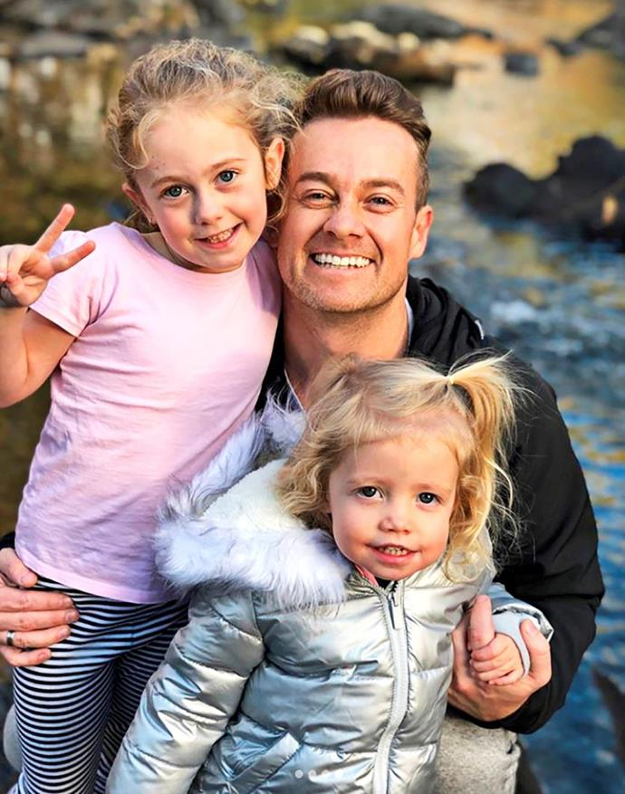 Grant with his adorable daughters Sailor, seven, and Scout, three. *(Image: TV Week)*