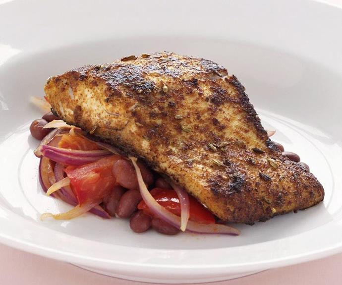 "**Cajun fish** <br><br> Beans, tomato and red onion make the perfect bed for these tender, flaky fish fillets dressed with a cajun spice rub. <br><br> See the full *Australian Women's Weekly* recipe [here](https://www.womensweeklyfood.com.au/recipes/cajun-fish-10618|target=""_blank"")."