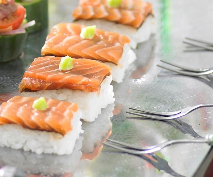 "**Salmon sushi** <br><br> Moulding the perfect mound of rice for sushi can be tricky. For precise and elegant results, try this salmon sushi made in one large piece, and sliced pre-serving. <br><br> See the full *Australian Women's Weekly* recipe [here](https://www.womensweeklyfood.com.au/recipes/salmon-sushi-18451|target=""_blank"")."