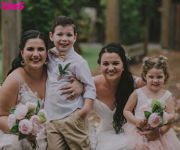 Emily and me with our kids Rhett, and Peyton, on our second wedding day.