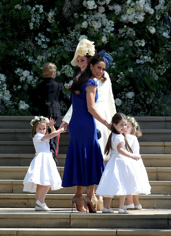 Jessica with Kate Middleton, with flower girls Princess Charlotte (left) and Ivy Mulroney, who was a flower girl. *(Image: Getty)*