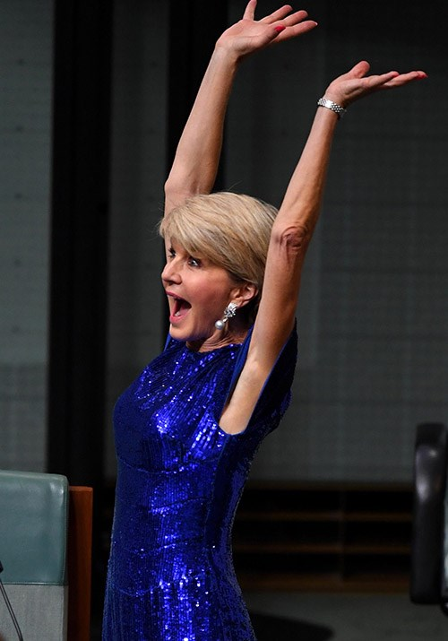 """The fashionable politician jumped for joy as the first budget surplus in over a decade was announced. <br><br> Sharing the celebratory picture to her Instagram, Julie said the announcement was """"great news for all Australians"""". *(Image: AAP)*"""