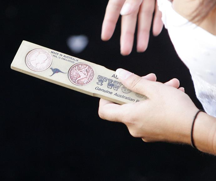"""This is the """"kip"""", the wooden board used to toss the coins. *(Image: Getty)*"""