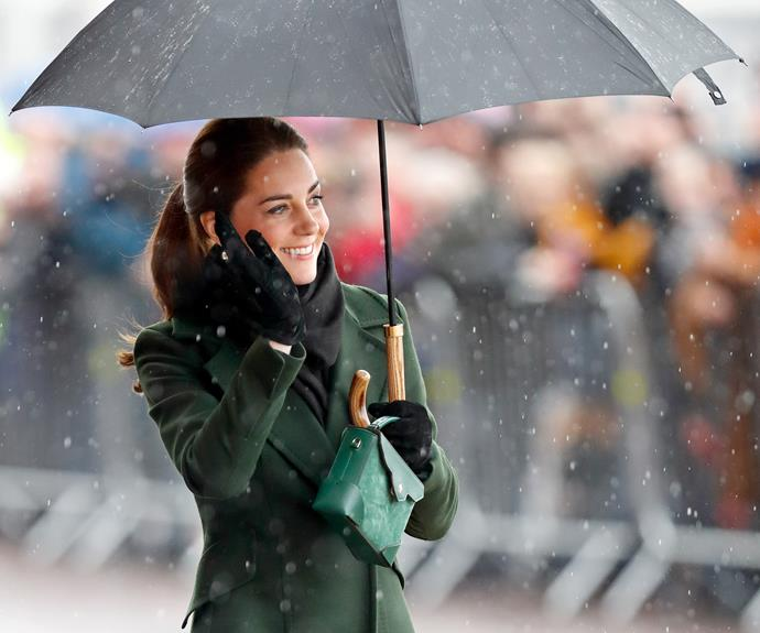 This is NOT what we look like in the rain. Duchess Catherine looked flawless during recent St Patrick's day celebrations in Ireland, while wearing a picture-perfect, head-to-toe green outfit. *(Image: Getty)*