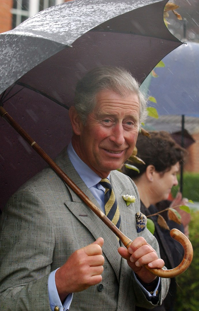 The rain doesn't seem to be bothering Prince Charles at all! *(Image: Getty)*