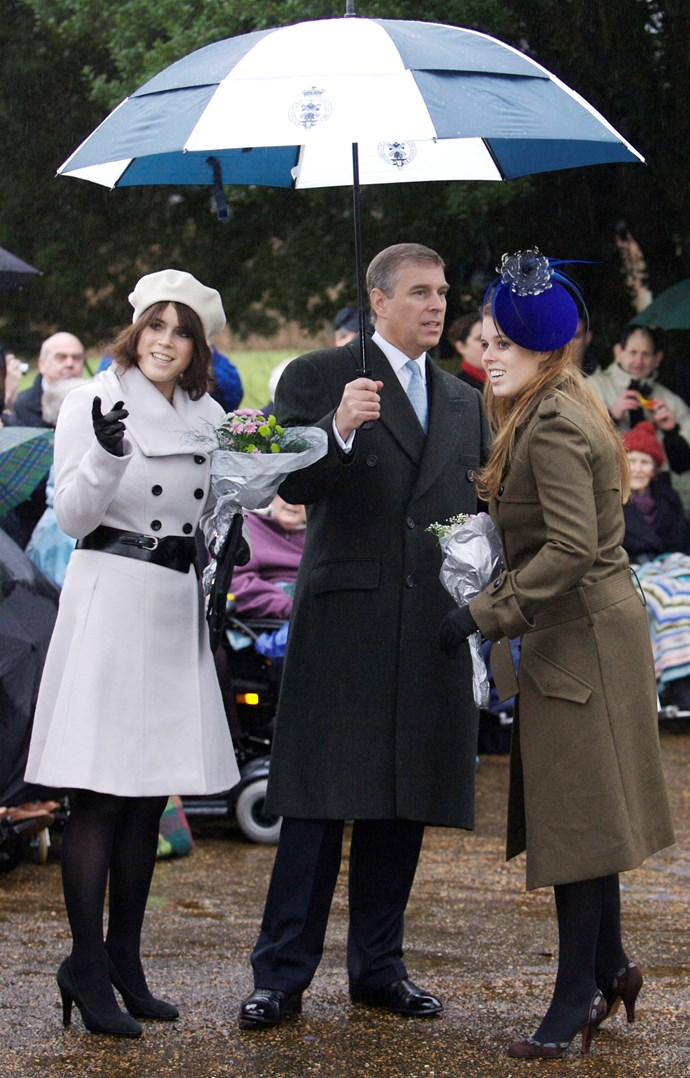 Princess Eugenie, Princess Beatrice and their father Prince Andrew keeping dry during the royal family's traditional Christmas service at Sandringham. *(Image: Getty)*