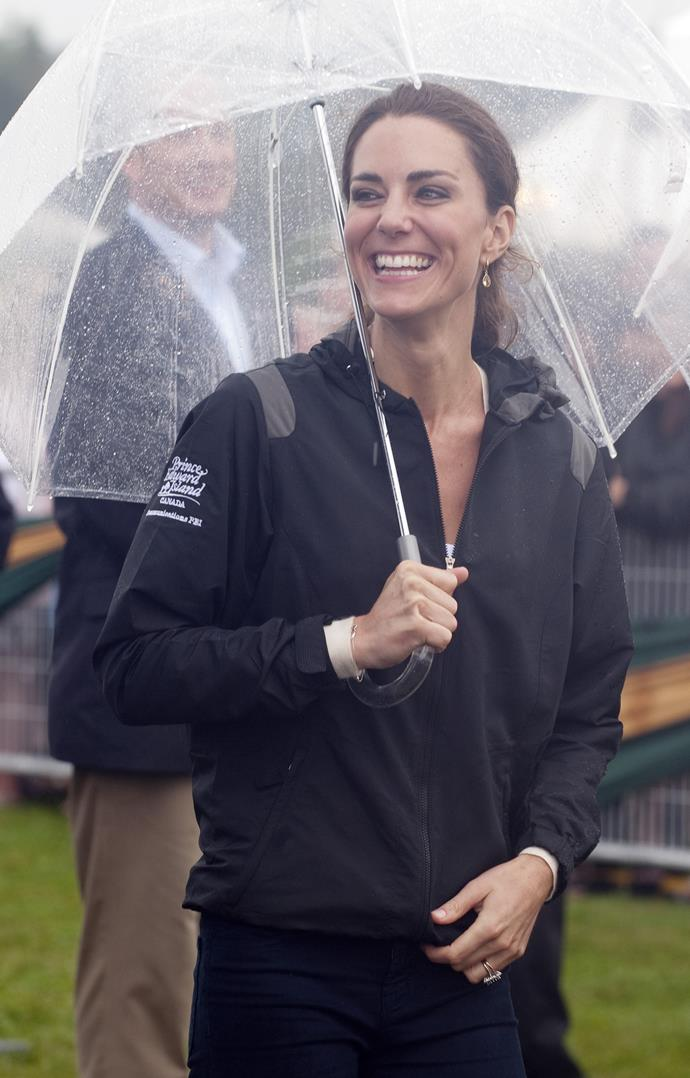 Isn't she just gorgeous? A low-key Duchess Catherine beaming, not letting the elements get her down one bit! *(Image: Getty)*