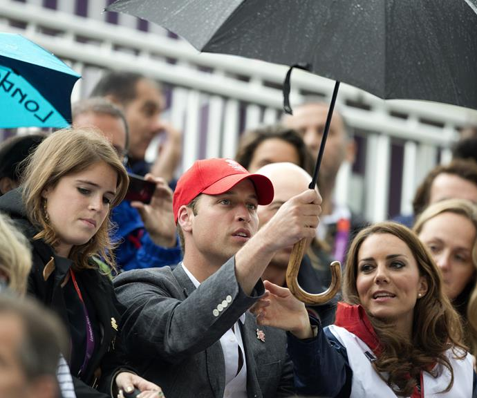 Princess Eugenie, Prince William and Duchess Catherine braving the elements together a few years ago. *(Image: Getty)*