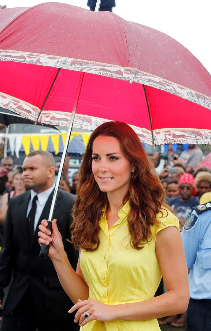 Duchess Catherine looking stunning in yellow, while on tour in the Solomon Islands in 2012.