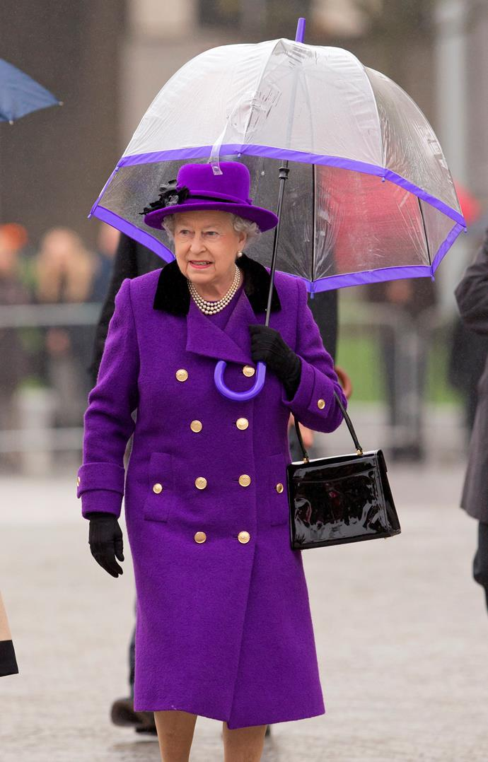 This is one of our favourite outfits on the Queen. That bold purple is certainly a regal choice! *(Image: Getty)*