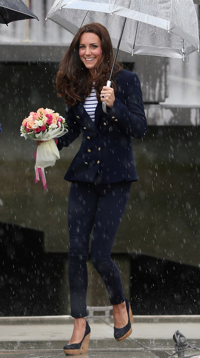We don't know about you, but we certainly don't look this good while running through the rain! How DOES Kate do it?! *(Image: Getty)*