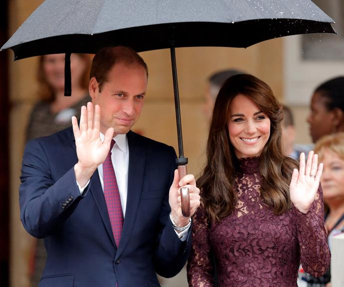Prince William being a total gentleman, keeping Kate dry while out and about on an official engagement. *(Image: Getty)*