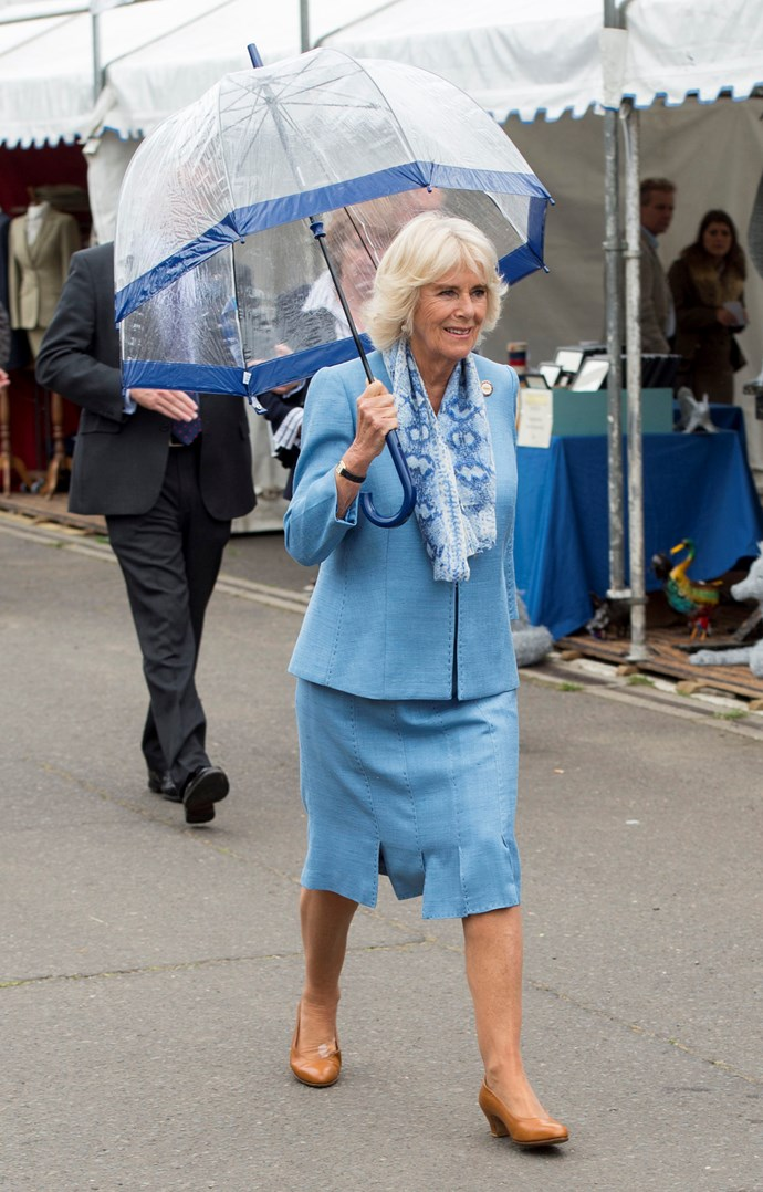 Camilla channelling the Queen with a matching umbrella and suit combo. *(Image: Getty)*