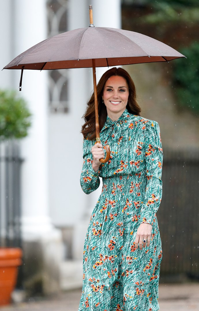 Duchess Catherine looking glorious in this pretty floral frock, keeping that impeccable blow-dry fresh. *(Image: Getty)*