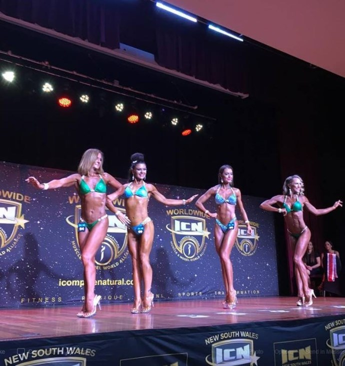 Natalie (pictured far left) has stunned everyone with her transformed physique and new hobby. *(Image: Facebook / ICN NSW)*