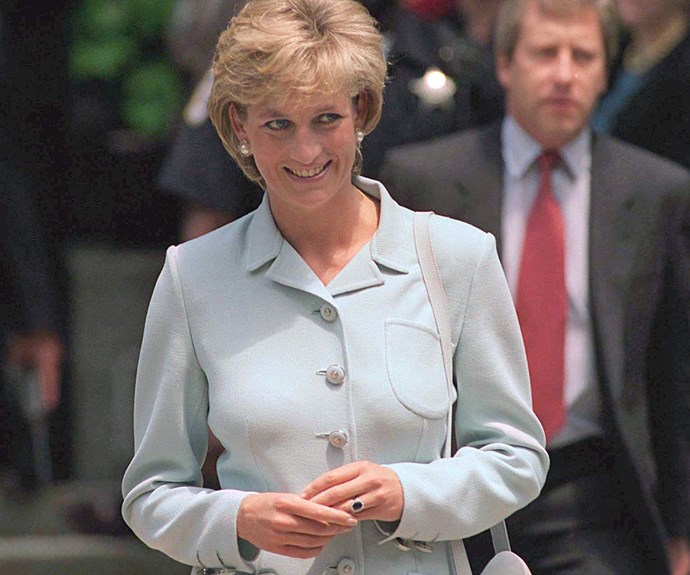 Princess Diana wearing her iconic sapphire engagement ring, which is now worn by her daughter-in-law Kate Middleton. *(Image: Getty)*