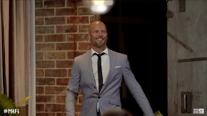 Mike enters the reunion dinner party on his own. *(Source: Channel 9)*