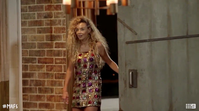 Heidi enters the final reunion dinner party by herself. *(Source: Channel 9)*