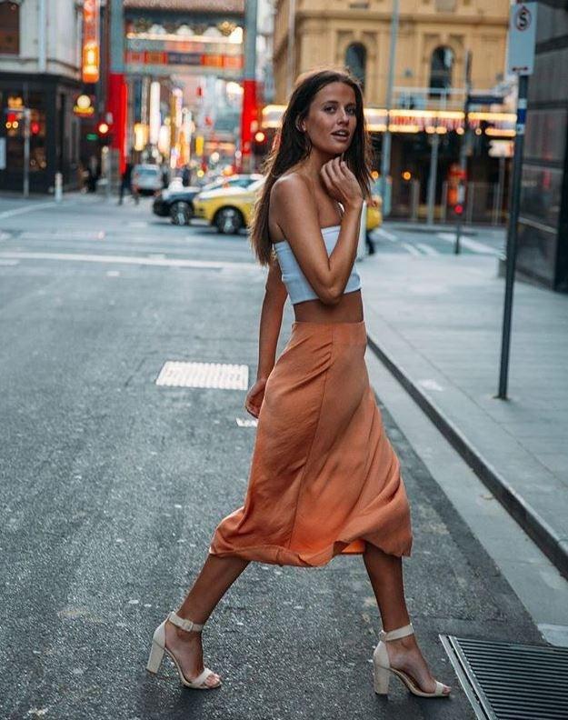A certain satin-style skirt has lent itself to huge success for Cotton On. *(Image: Instagram / @cottonon)*