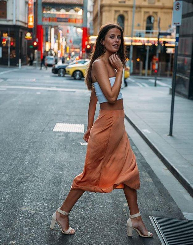 A certain satin-style skirt has lent itself to huge success for Cotton On. *(Image: Instagram / @cottonon)*