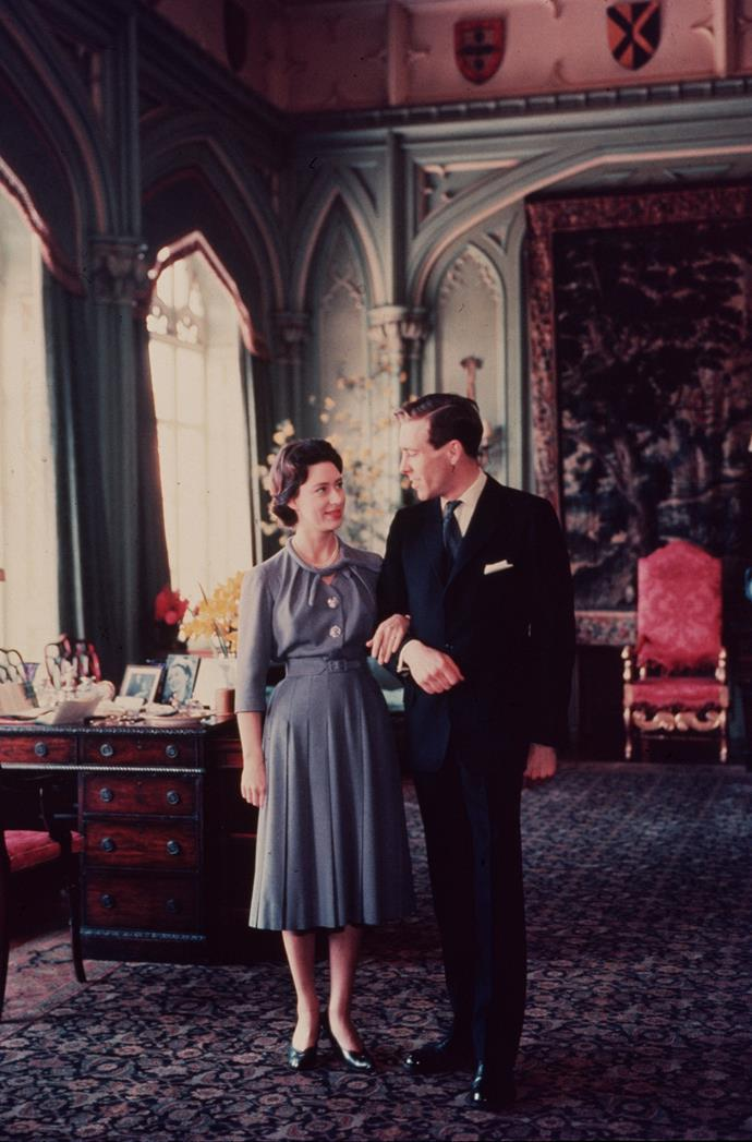Margaret and Tony pose for formal photos while holidaying with the Queen Mother in 1960. *(Image: Getty)*