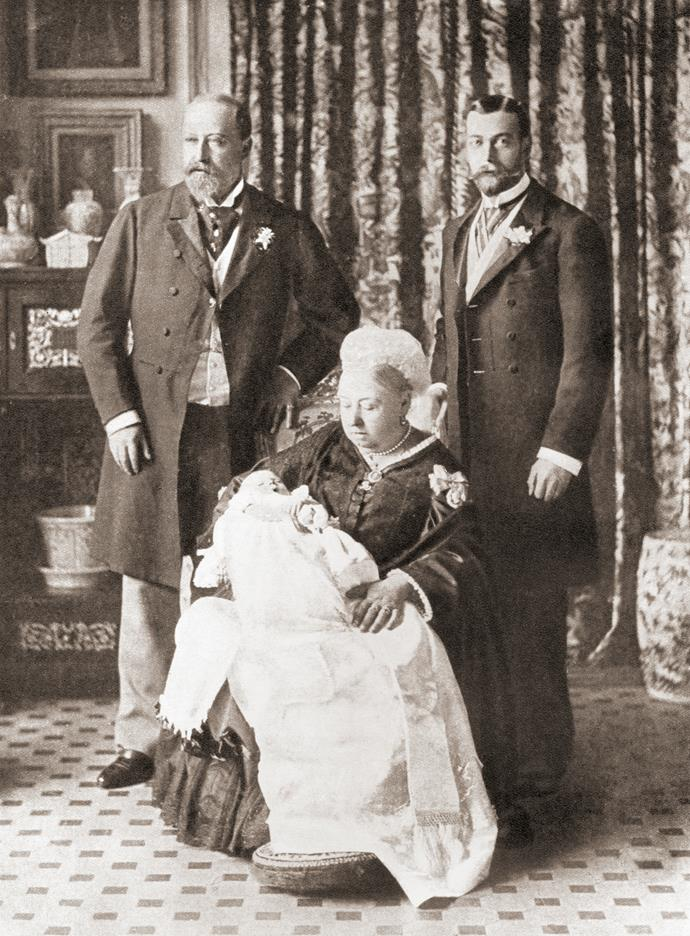 """Queen Victoria, flanked here by her son Edward and grandson George, lived during a time when childbirth would take place at home (or as homely as a palace is!). <br><br> What's more, a packed out room of witnesses would also attend the birth (as back up to swear there had been no foul play should the baby pass away). Ladies-in-waiting, midwives, servants and doctors would also make up the population of said birthing room, according to *[The Guardian](https://www.theguardian.com/uk-news/2013/jul/23/royal-births-protracted-painful-public