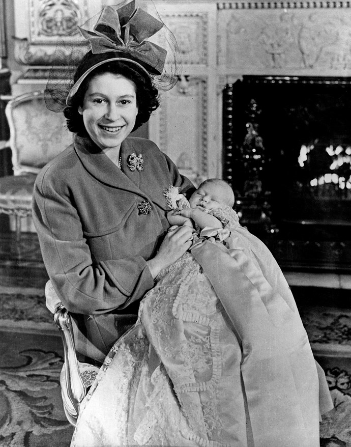 """The then Princess Elizabeth gave birth to Prince Charles not long before becoming Queen of England. Born at Buckingham Palace, Elizabeth was reportedly in labour for a whopping 30 hours, ending in a caesarean section.  <br><br> Notably, Prince Phillip was not present at the time, instead it is understood he was playing squash in another part of the palace. But upon hearing of his first child's birth, he ran up to where Elizabeth and Charles were, declaring his new son's physique as similar to that of a """"plum pudding"""".  *(Image: Getty)* <br><br> **Watch some sweet footage below of Queen Elizabeth playing with young Prince Charles. Story continues after video...**"""