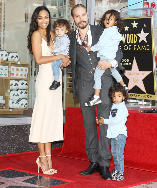 Zoe Saldana with her husband, Marco Perego and their children, Bowie, Cy and Ezio attend the ceremony honouring Zoe with a star on The Hollywood Walk of Fame in 2018. *Image: Getty.*
