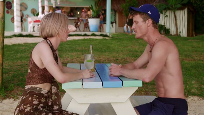 Alex Nation and Richie Strahan sit across from each other in a tense convo. *(Source: Network Ten)*