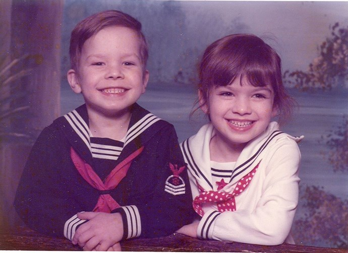 """Recognise this cheesy smile? Jimmy Fallon shared this adorable picture of himself and sister Gloria to Twitter, writing: """"Nothing like @gloriafallon123 and I in sailor outfits to celebrate #NationalSiblingsday #StillSmiling"""" *(Image: Twitter / @jimmyfallon)*"""