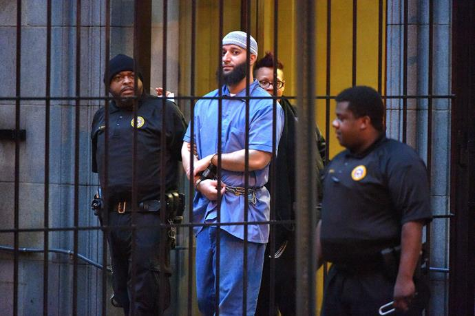 Syed pictured in 2016 outside a courthouse in Baltimore. *(Image: Getty)*
