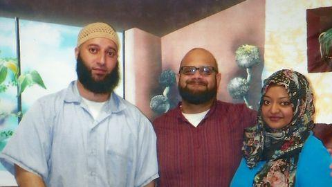 Adnan Syed in his prison clothes with an unidentified friend (centre) and Rabia Chaudry (right), a family friend of Syed who has become his fierce advocate. *(Image: HBO)*