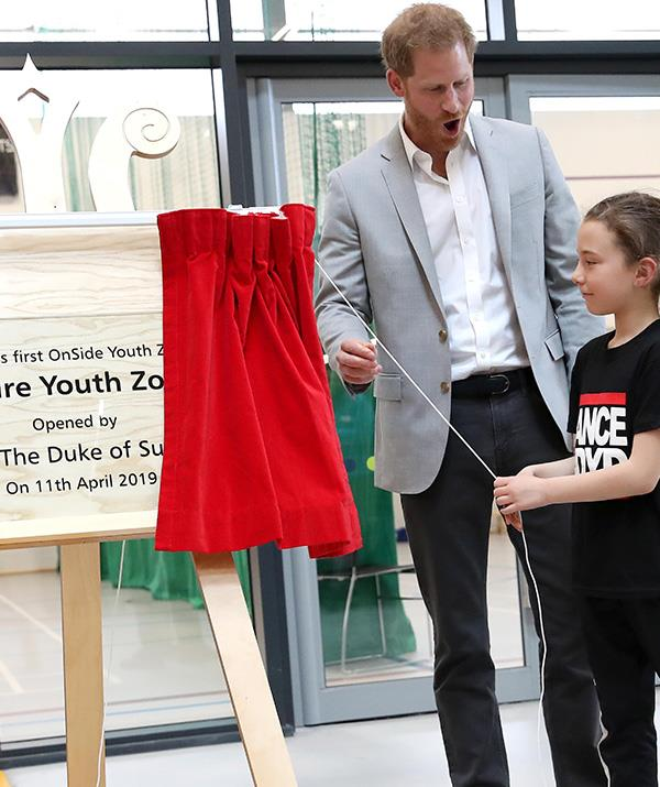 Prince Harry was in the best spirits as he celebrated the opening of a youth centre. *(Image: Getty)*