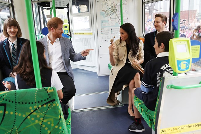 The ever-sensible Meghan wore flats for her commute. *(Image: Getty)*