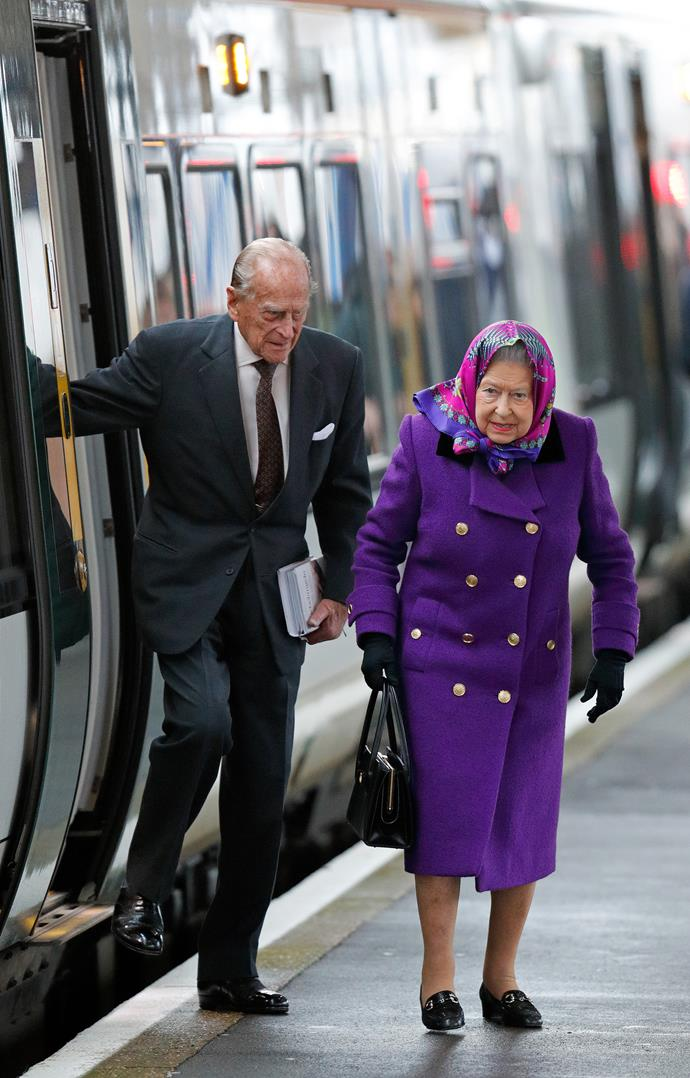 Prince Philip and the Queen exit a train together. *(Image: Getty)*
