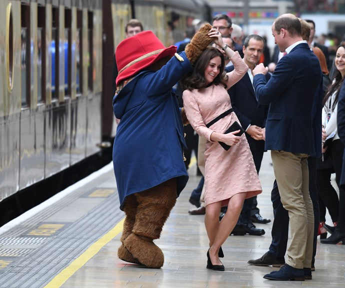 Too cute! Kate has a dance on the train platform. *(Image: Getty)*