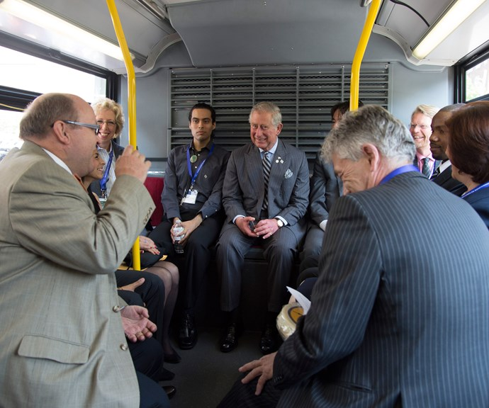Prince Charles chats with members of the public on the bus. *(Image: Getty)*