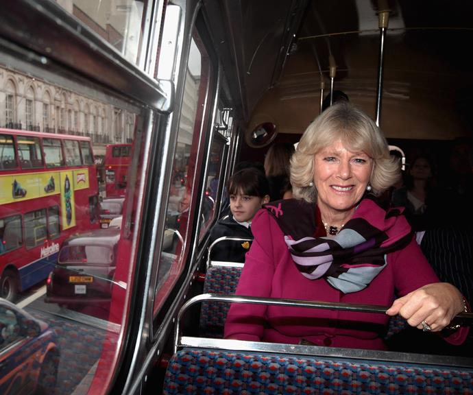 Camilla is loving being on this classic London double-decker bus! *(Image: Getty)*